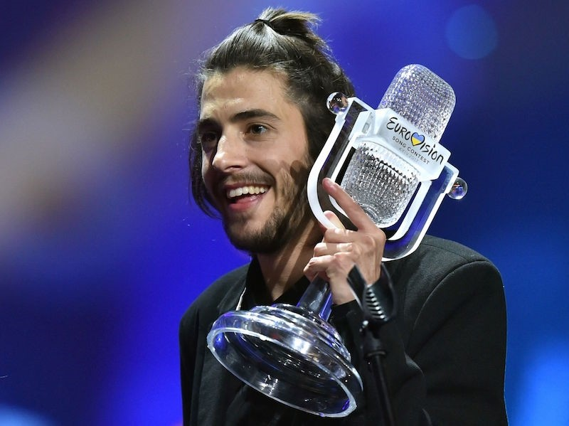 Portuguese singer representing Portugal with the song ,Amar Pelos Dios,, known as  Salvador Sobral, holds the trophy as he celebrates on stage after winning the final of the 62nd annual Eurovision Song Contest. AFP Photo