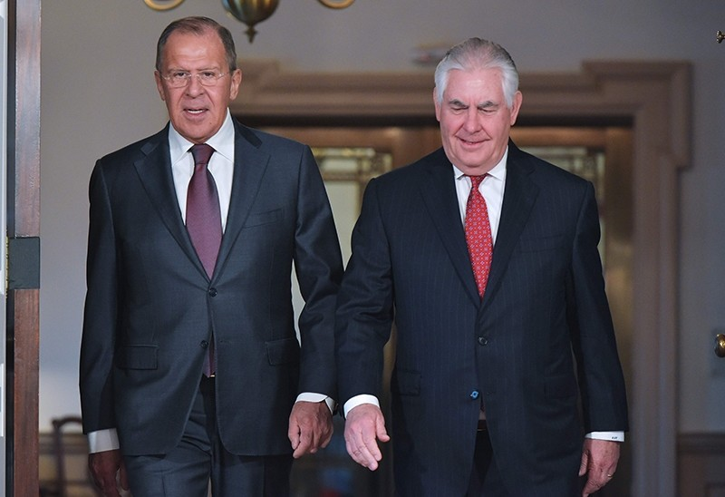 This file photo taken on May 10, 2017 shows Russian Foreign Minister Sergei Lavrov (L) and US Secretary of State Rex Tillerson (R) arriving for photos in the Treaty Room of the State Department in Washington, DC (AFP Photo)