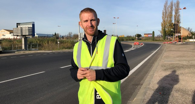 "Ghislain Coutard, the ""vestman"" on a highway while trying to gather signatures for a proposed referendum (Photographs taken by Emre Başaran)"
