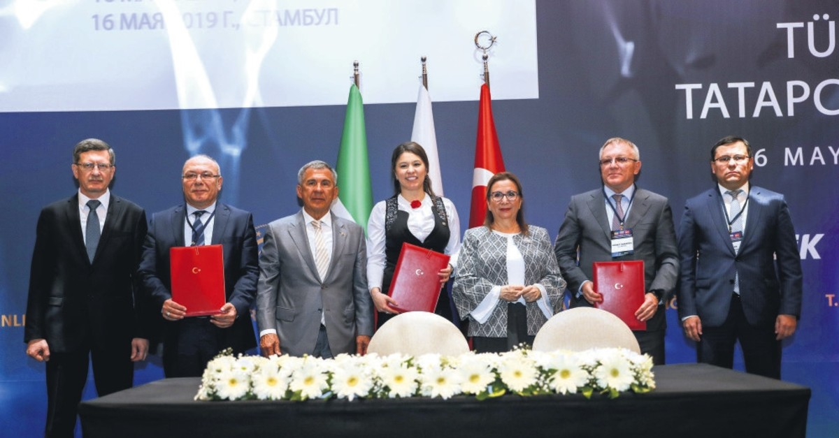 Trade Minister Ruhsar Pekcan, third from right, and Tatarstan President Rustam Minnikhanov, third from left, participated in the Turkey-Tatarstan Business Forum organized by Foreign Economic Relations Board, Istanbul, May 16, 2019.