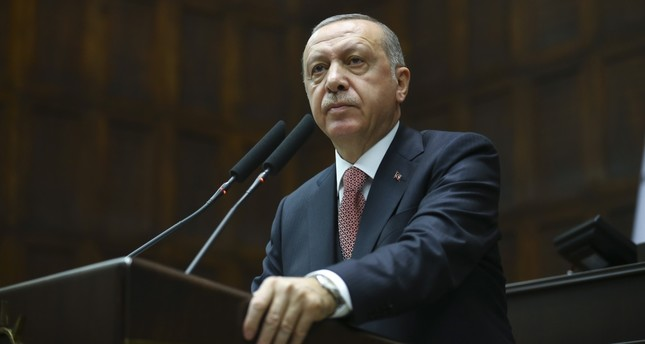 President Recep Tayyip Erdoğan addresses members of his ruling AK Party during a meeting in Parliament yesterday.