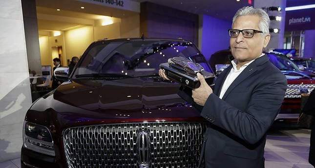In this Jan. 15, 2018, file photo, Kumar Galhotra, group vice president for Lincoln stands next to the 2018 Lincoln Navigator at the North American International Auto Show in Detroit. (AP Photo)
