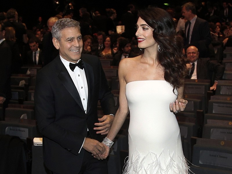 In this Feb. 24, 2017 file photo, actor George Clooney, left, and Amal Clooney arrive at the 42nd Cesar Film Awards ceremony at Salle Pleyel in Paris (AP Photo)