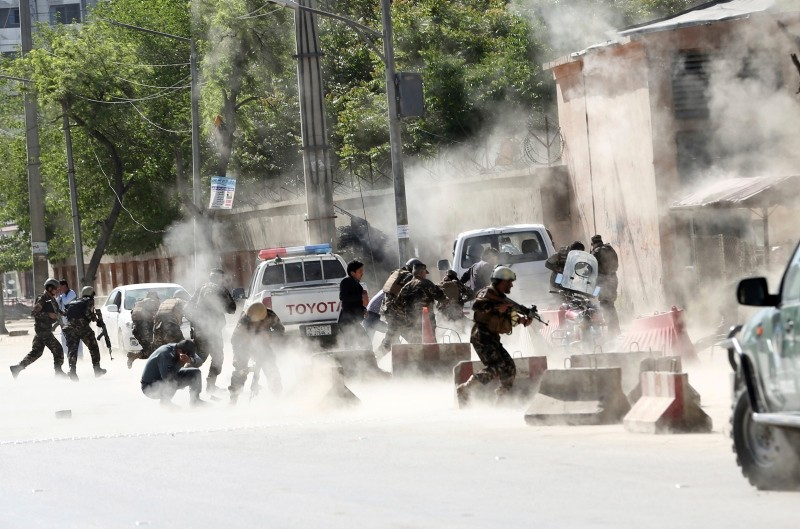 Security forces run from the site of a suicide attack after the second bombing in Kabul, Afghanistan, Monday, April 30, 2018 (AP File Photo)