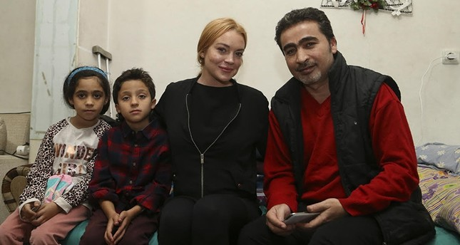 Lindsay Lohan with the Hussein family in Istanbul's Sultanbeyli district, September 25, 2016 (AA Photo)