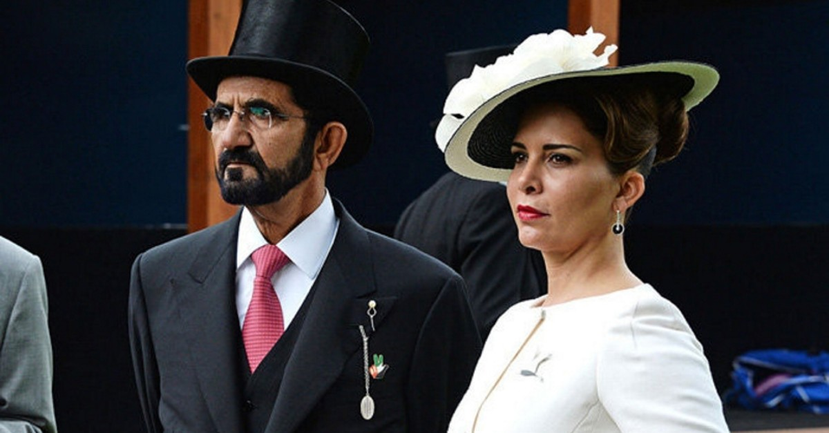 Sheikh Mohammed bin Rashid Al Maktoum (L) and Princess Haya attend Derby Day during the Investec Derby Festival, celebrating The Queen's 90th Birthday, at Epsom Downs Racecourse on June 4, 2016 in London, England. (Getty Images)