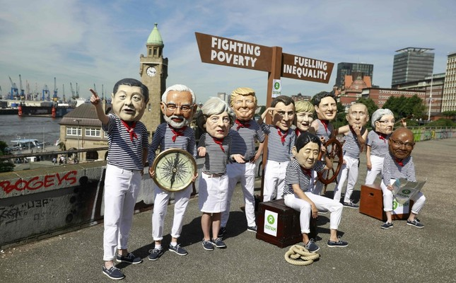 Activists protest against world leaders ahead of the G20 Summit held in Hamburg, Germany, July 6, 2017.
