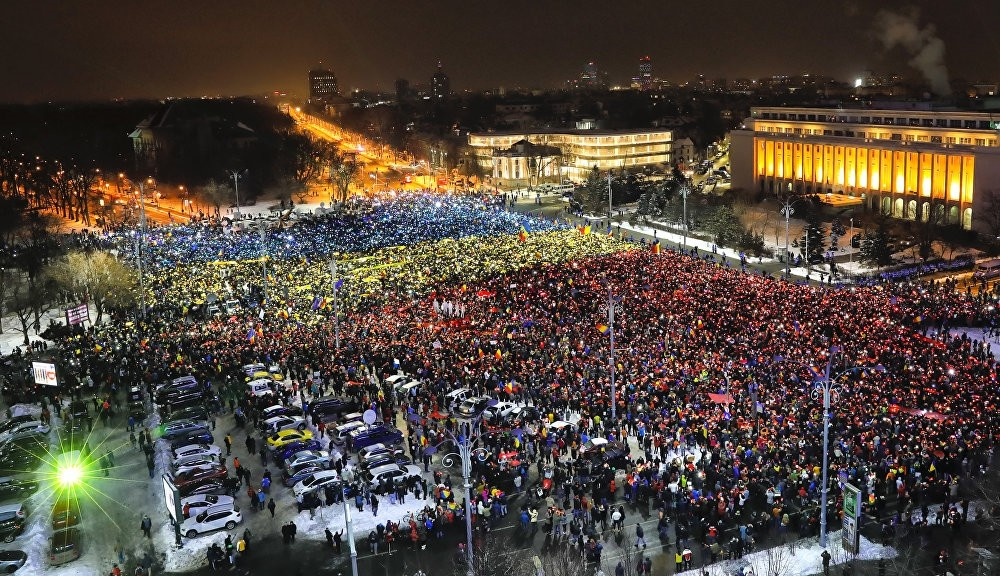 In Bucharest, protesters created a huge Romanian flag with their mobile phones. (AP Photo)