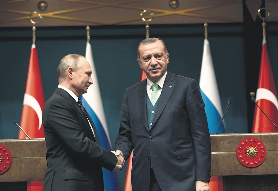 President Erdou011fan shakes hands with his Russian counterpart Putin following their meeting, at Presidential Complex, Ankara, Dec. 11.
