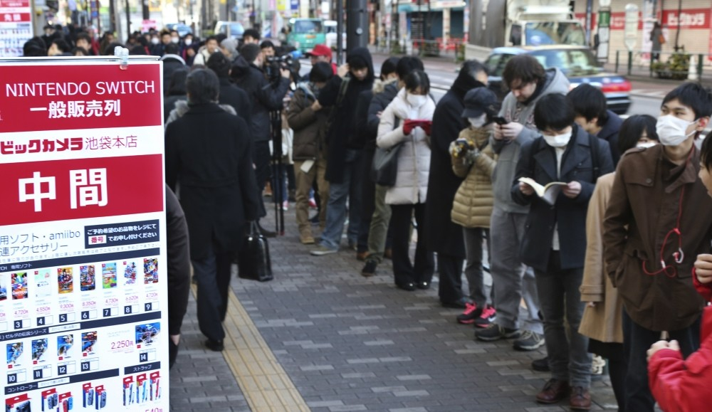 Shoppers line outside of retail store Bic Camera to buy Nintendou2019s newest computer game u201cSwitchu201d in central Tokyo. (AP Photo)