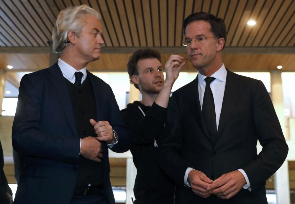 Geert Wilders of the PVV and Dutch PM Rutte (R) of the VVD take part in the debate in Rotterdam, on Monday.