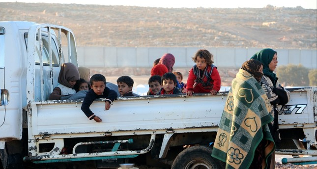 Syrians flee Assad regime's heavy bombing during a recent military operation in northern Hama and Idlib.