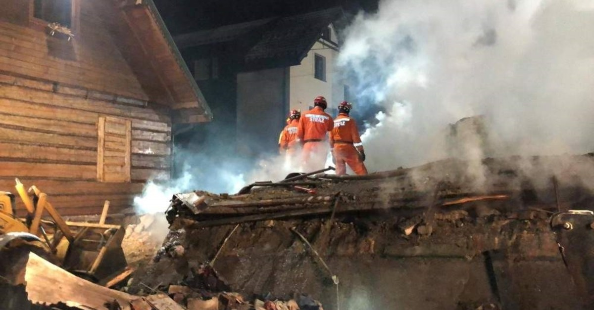 Firefighters work at the site of a building, leveled by a gas explosion, in the ski resort town of Szczyrk, Poland, Dec. 5, 2019, in this image obtained from social media. (Radio Bielsko via Reuters)