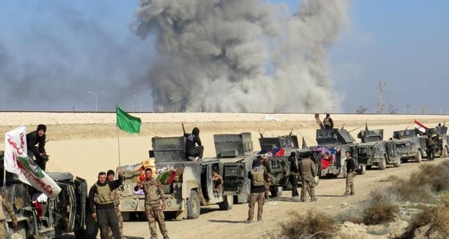 ميليشيا وقوات عراقية في صحراء الأنبار أثناء الحرب على داعش (من الأرشيف)