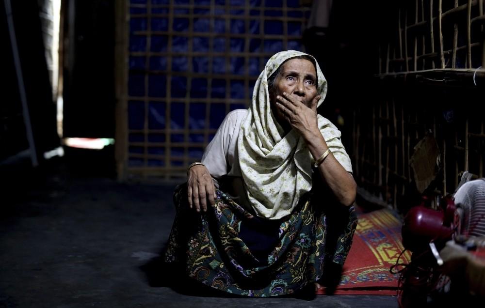 An elderly Rohingya refugee sits inside a family shelter in Kutupalong refugee camp, Bangladesh, Aug. 28.