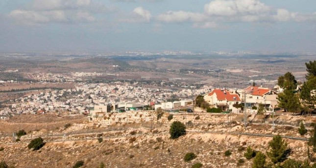 A picture taken on Dec. 1, 2019, shows the Jewish settlement of Negohot (R), located near the Palestinian village of Beit Awwa (L) in the Israeli occupied West Bank. (AFP Photo)