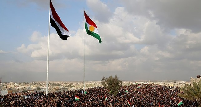 Iraqi and KRG flags seen together during Nevruz celebrations in Kirkuk's historic citadel, March 20, 2017. (AA Photo)