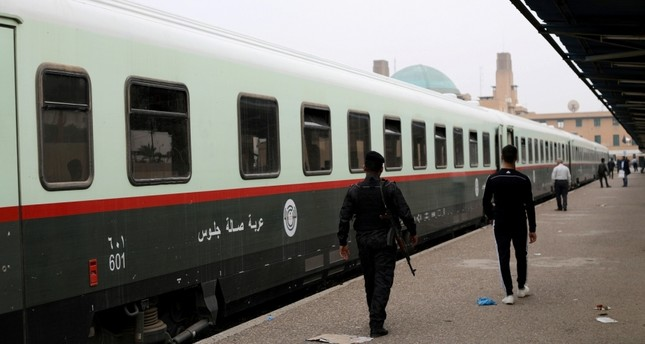 Passengers walk on a platform before boarding a train to Fallujah, the newly resurrected service to the city, at a railway station in Baghdad, Iraq Nov. 7, 2018. (Reuters Photo)