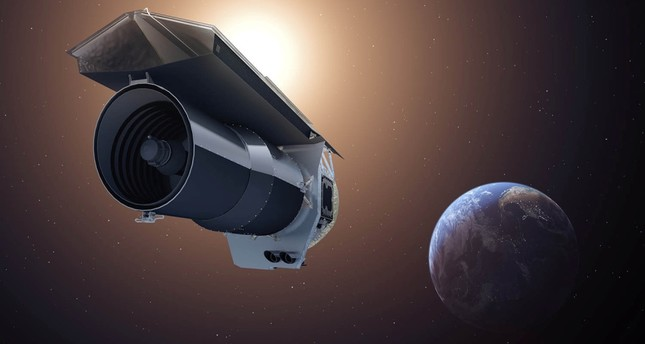 An artist's imprission shows NASA's Spitzer Space Telescope as it begins its Beyond mission.