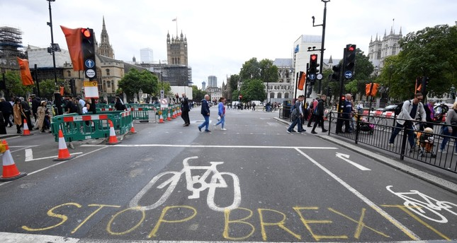 Writing on the road that reads Stop Brexit seen near the Houses of Parliament, London, Sept. 11, 2019.