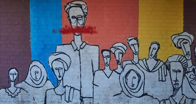 A wall painted by graffiti artists in Sudan describes the mood of the people.