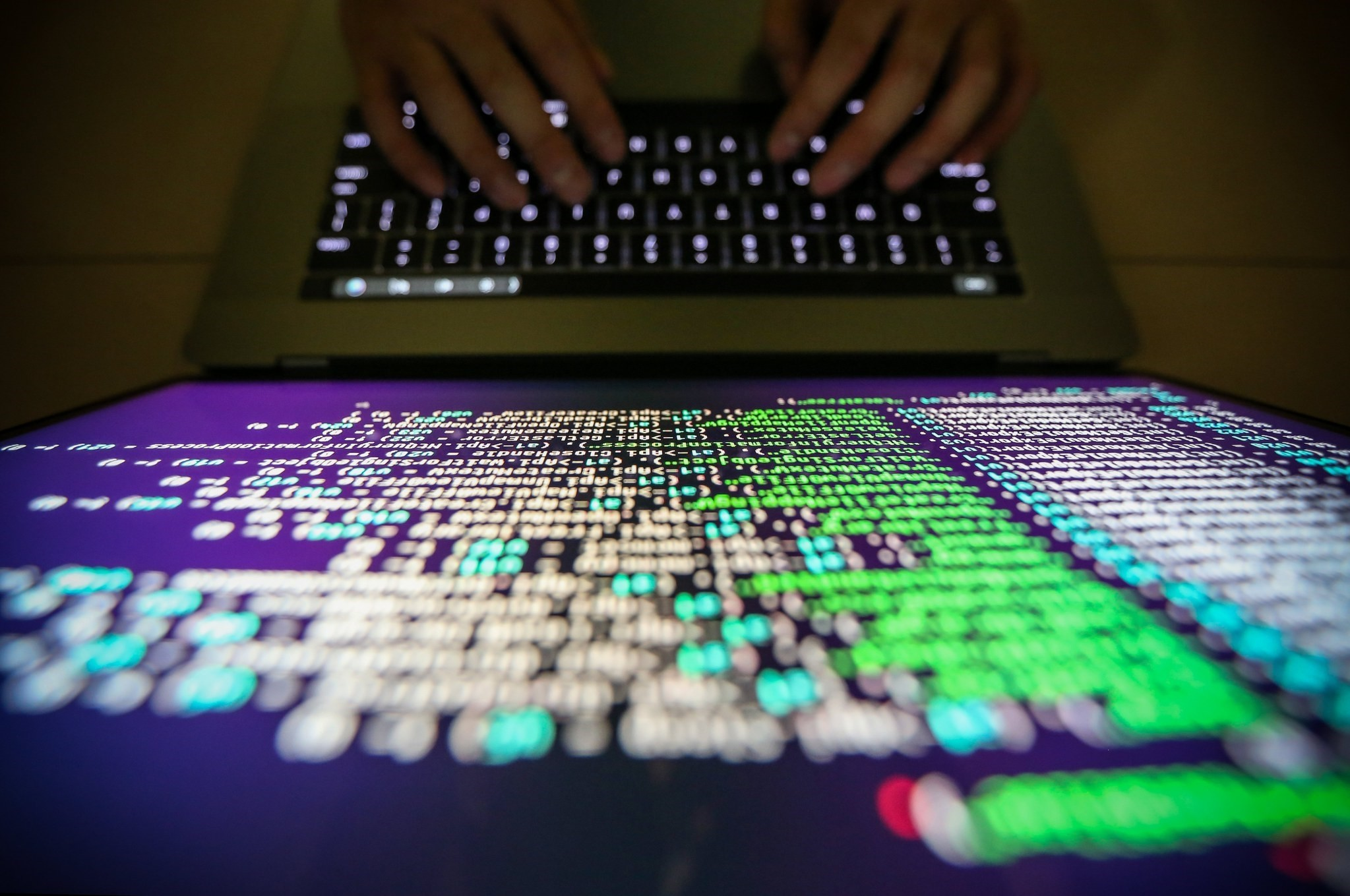 A programer shows a sample of decrypting source code in Taipei, Taiwan, 13 May, 2017. (EPA Photo)