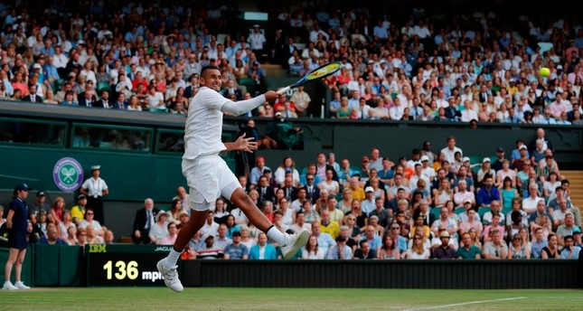 Australia's Nick Kyrgios returns against Spain's Rafael Nadal during their men's singles second round match on the fourth day of the 2019 Wimbledon Championships at The All England Lawn Tennis Club in Wimbledon, on July 4, 2019. AFP Photo