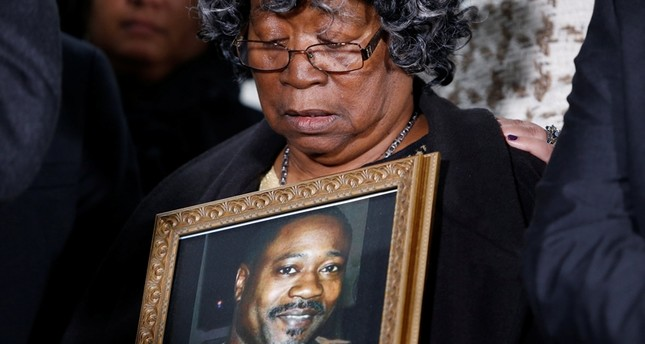 Judy Scott looks over a photo of her son Walter Scott during a news conference after former police officer Michael Slager was sentenced to 20 years in prison, in Charleston, South Carolina, U.S., December 7, 2017. (Reuters Photo)