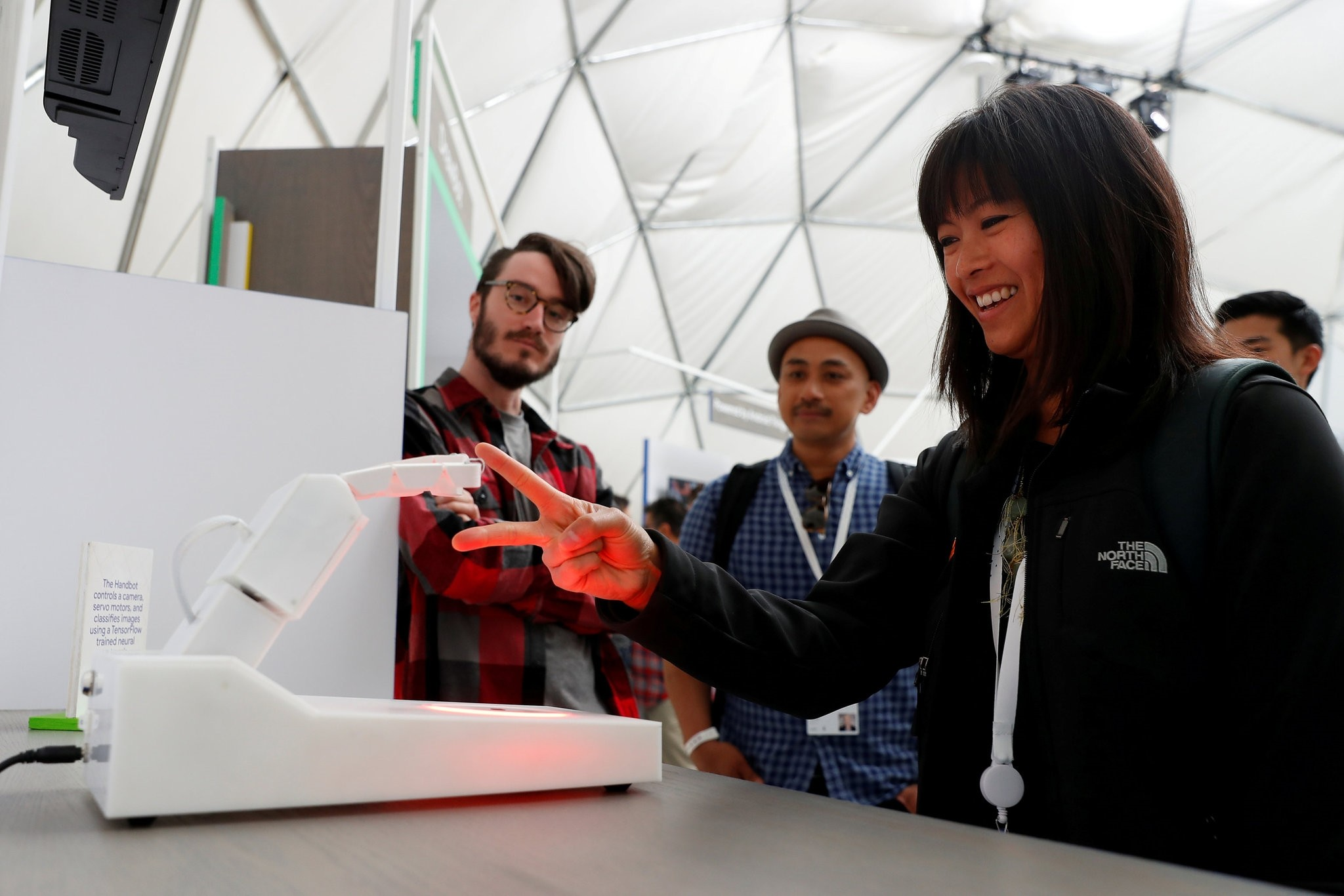 An attendee competes in a game of rock, paper, scissors against a Handbot robot during the annual Google I/O developers conference in Mountain View, California, May 8, 2018.