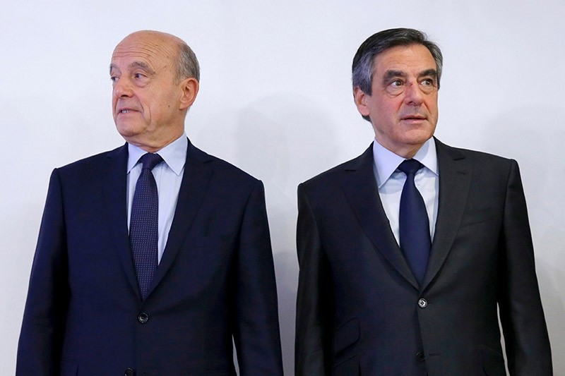 Franu00e7ois Fillon (R), center-right Les Ru00e9publicains [The Republicans] party's presidential candidate, and former PM Alain Juppu00e9 stand together. (File Photo)