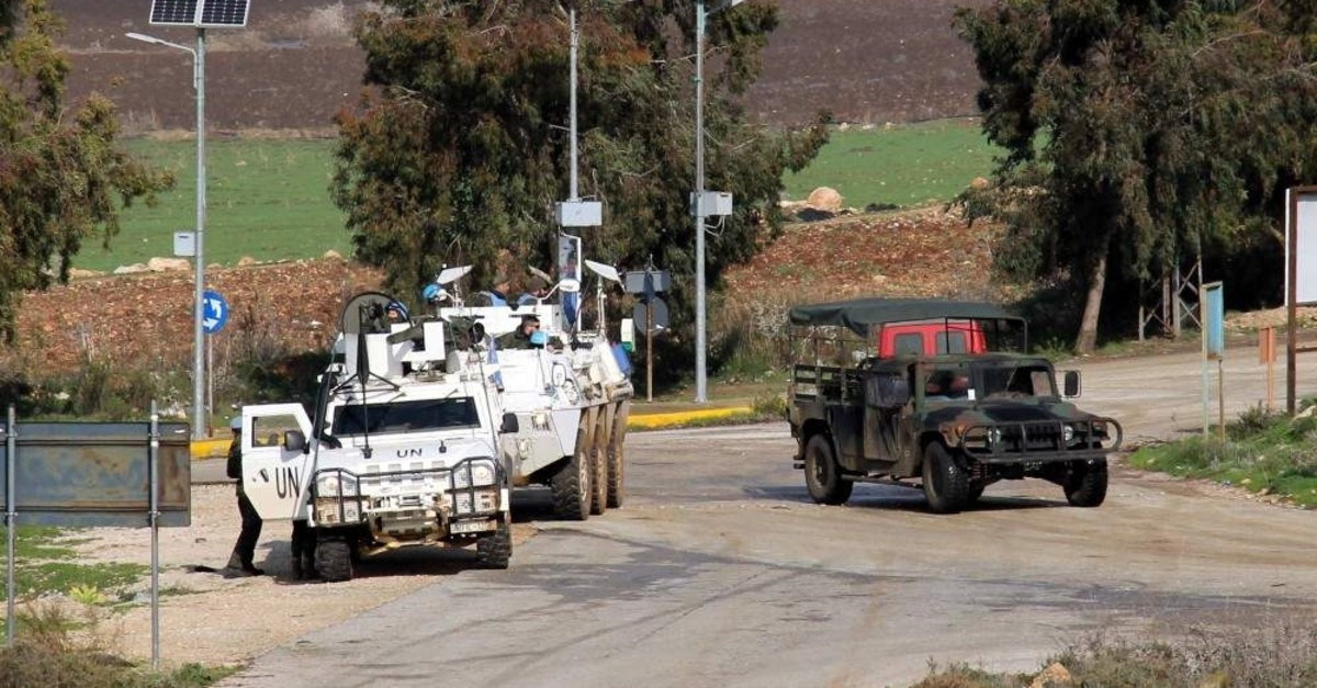 Vehicles of U.N. Interim Forces in Lebanon (UNIFIL) are seen on a road in the southern Lebanese town of Kfar Kila near the border with Israel, Jan. 3, 2019. (AFP Photo)
