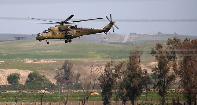 Iraqi army helicopters are seen on the outskirts of western Mosul on April 6, 2017 (AFP Photo)