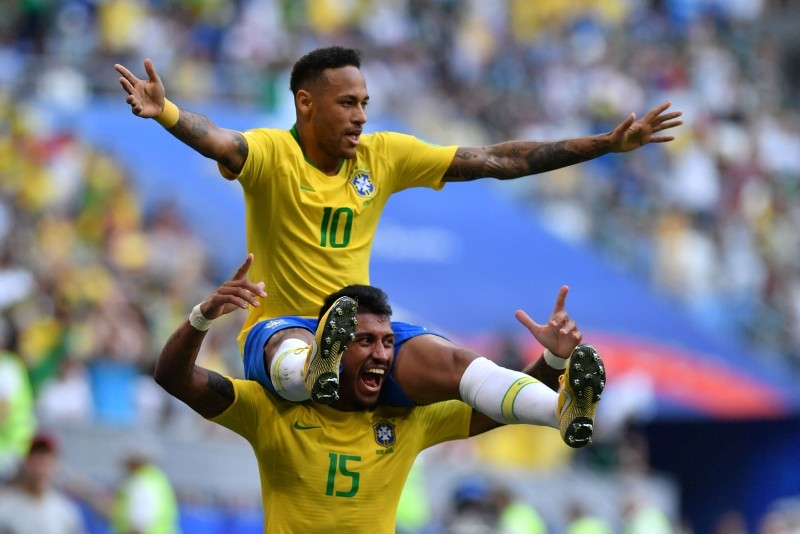 Brazil's forward Neymar celebrates with Brazil's midfielder Paulinho after scoring the opening goal during the Russia 2018 World Cup. (AFP Photo)