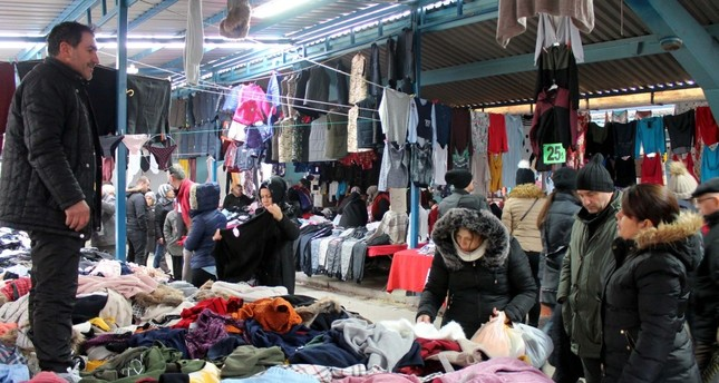 People shopping at the Ulus Pazarı, a local marketplace in Edirne.