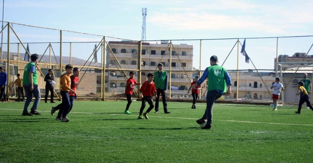 Syrian orphans play football in a match organized by ?HH in Afrin, Nov. 21, 2019.