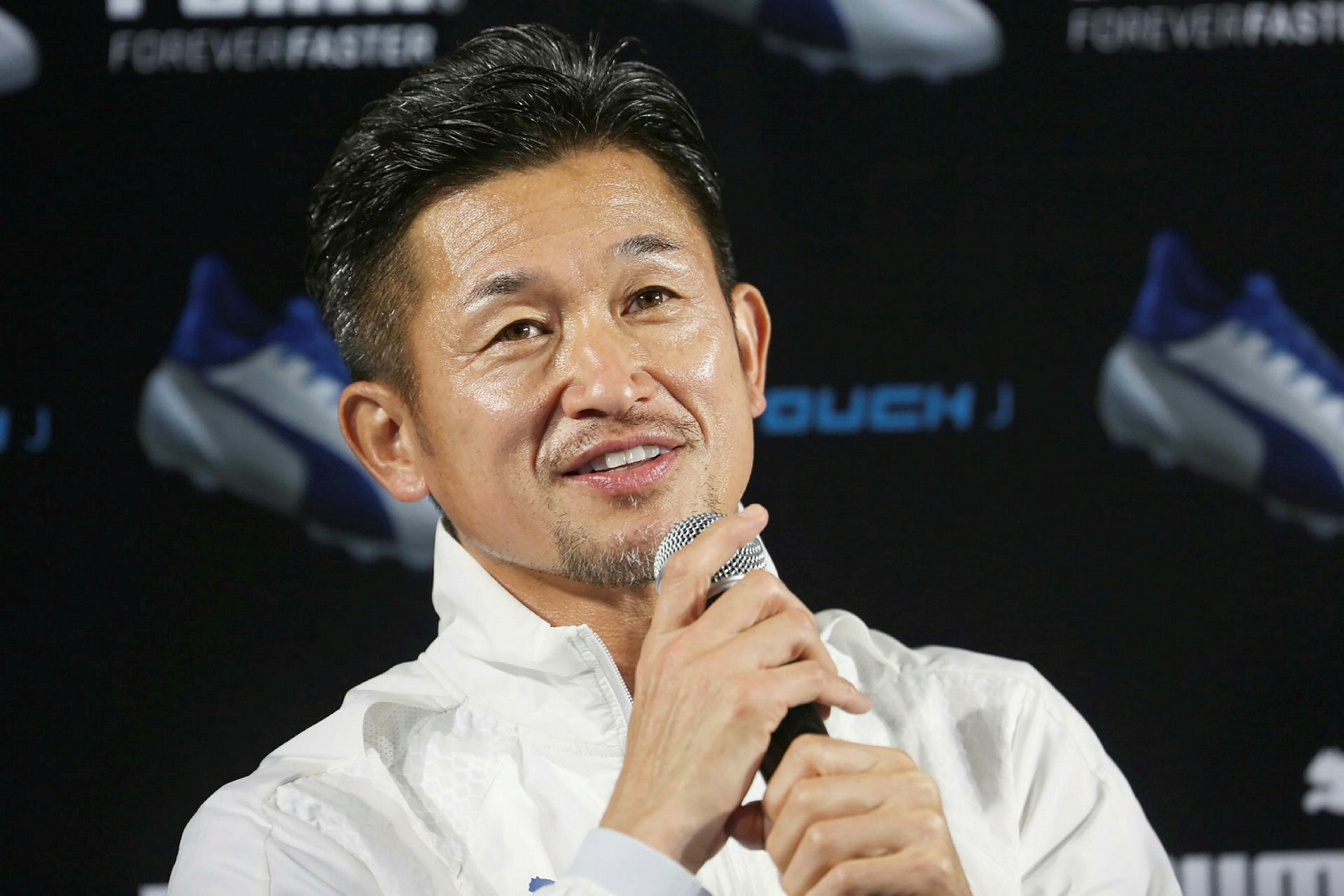 This picture taken on December 1, 2016 shows Japanese football player Kazuyoshi Miura speaking to journalists in Tokyo. (AFP Photo)
