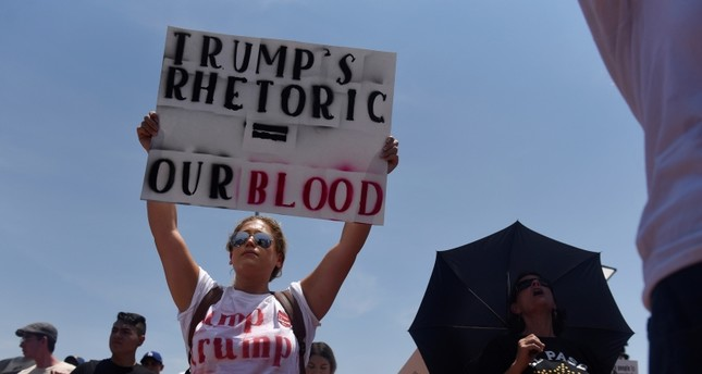People gather to protest President Donald Trump's visit four days after a mass shooting at a Walmart store in El Paso, Texas, U.S. August 7, 2019. (Reuters Photo)