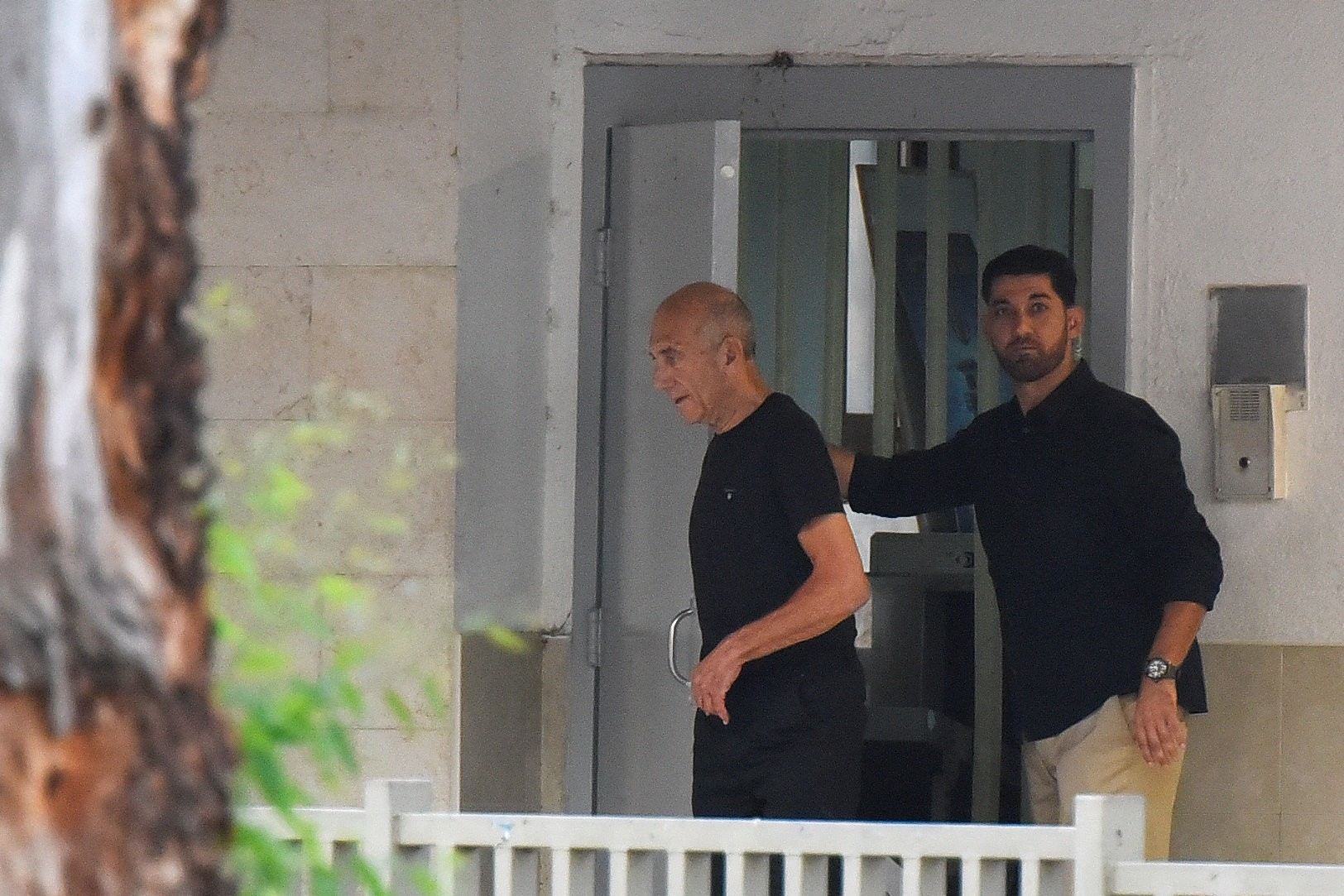 Ex-Israeli PM Olmert walks out of the prison door as he is released from prison after a parole board decided to cut his sentence by a third, at Maasiyahu prison July 2, 2017. (REUTERS Photo)