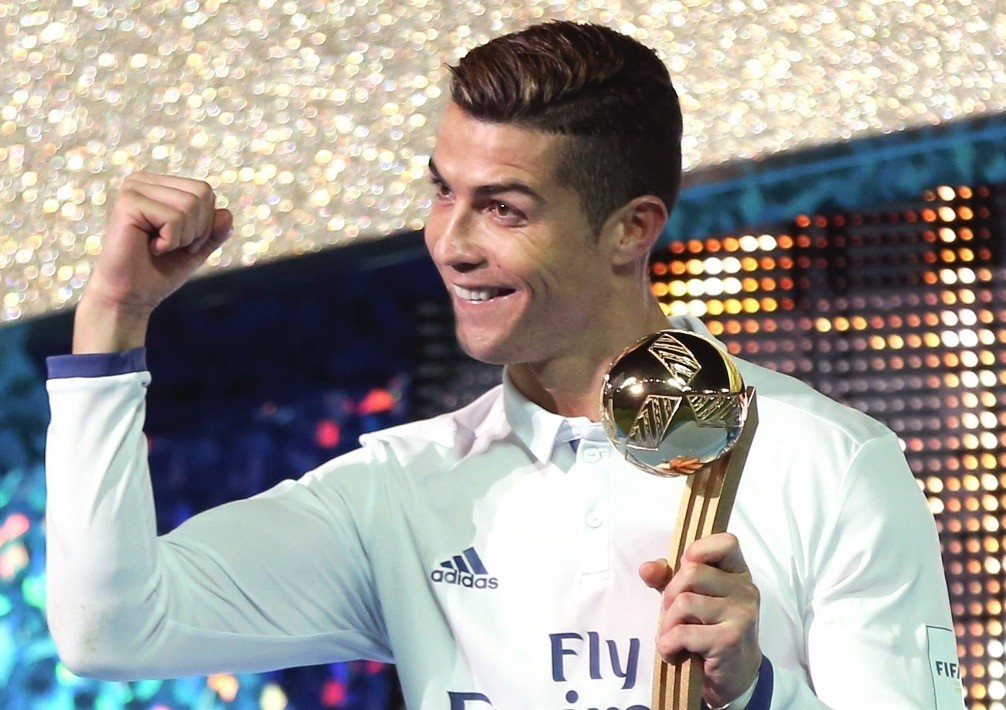 Real Madridu2019s Cristiano Ronaldo poses with the trophy after beating Kashima Antlers 4-2 to win the FIFA Club World Cup tournament in Yokohama, Dec. 18, 2016.