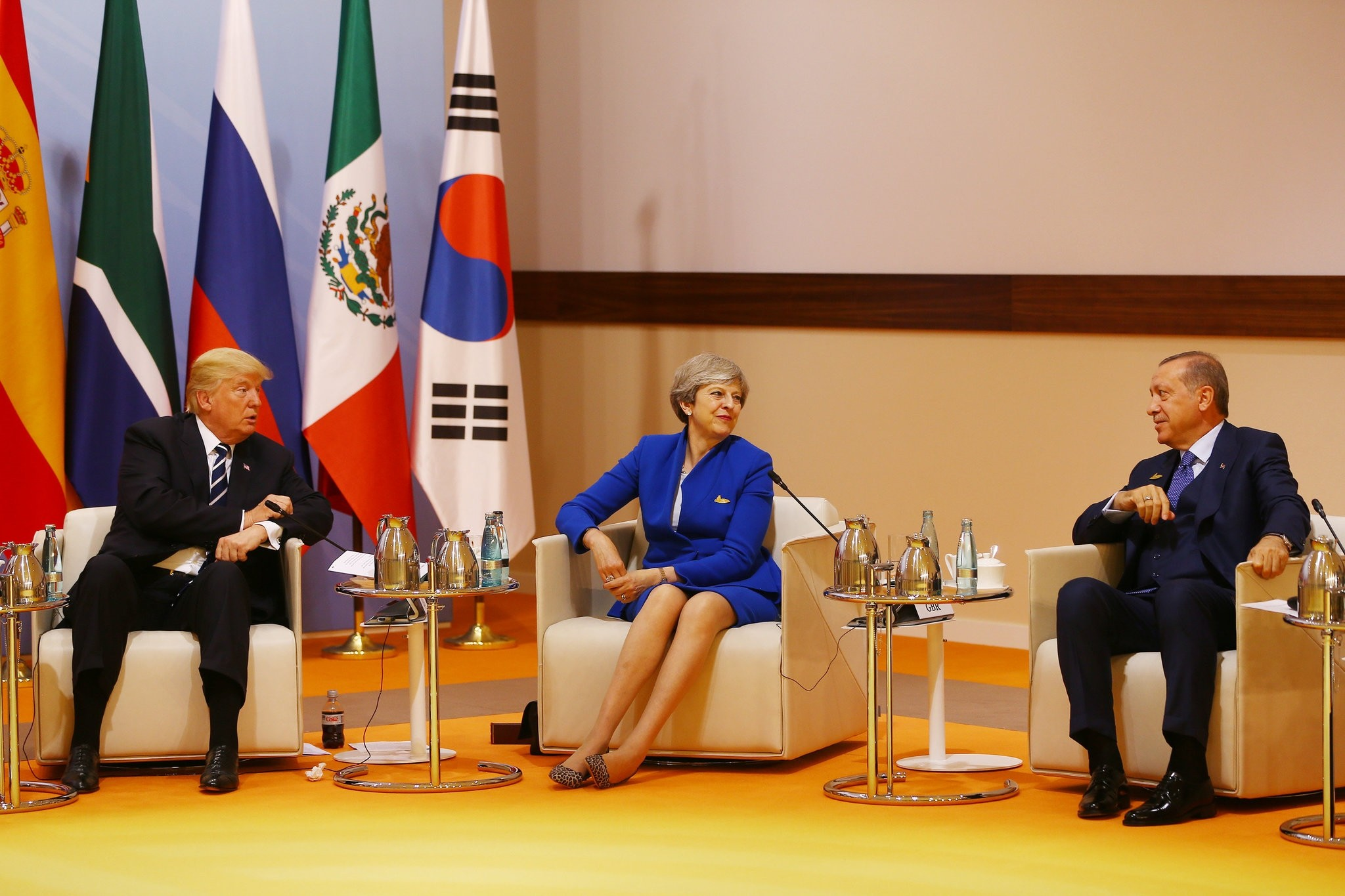 U.S. President Trump (L), British Prime Minister May (C) and President Erdou011fan during a session at the G20 summit, Hamburg, July 7, 2017.