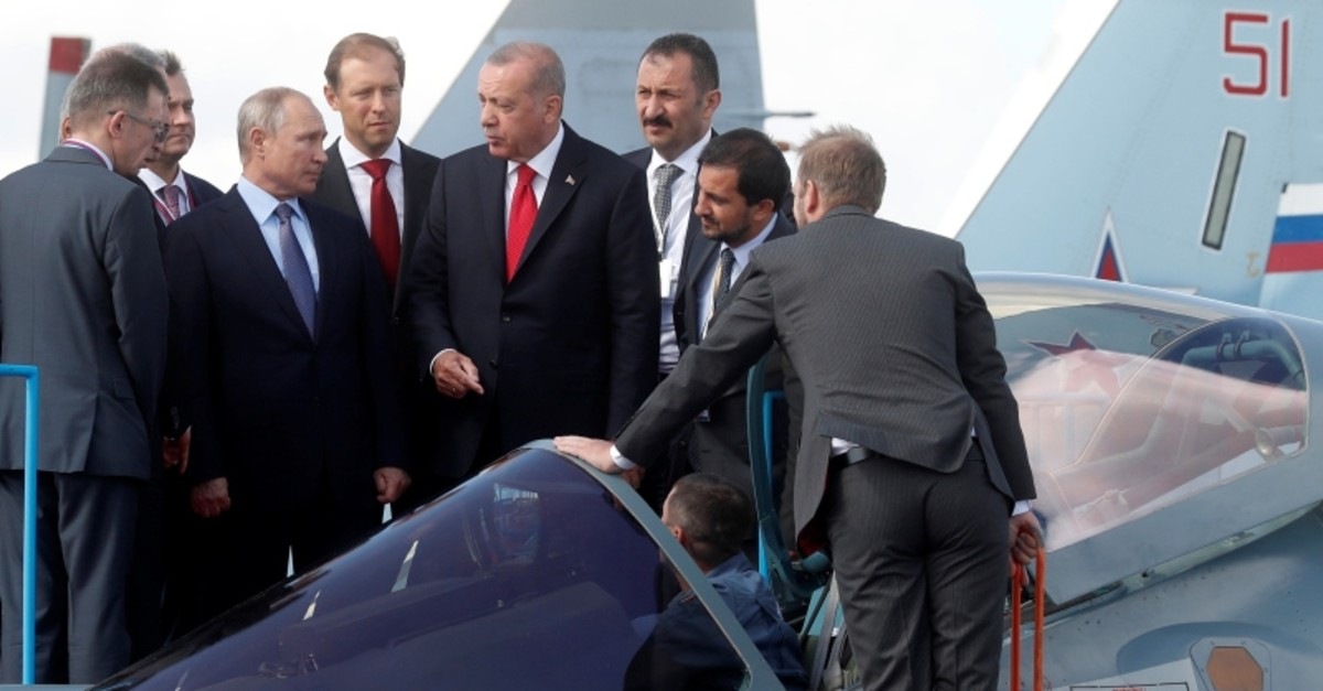 Russian President Vladimir Putin, Russian Industry and Trade Minister Denis Manturov and Turkish President Recep Tayyip Erdou011fan inspect a Sukhoi Su-57 fighter during the MAKS-2019 in Moscow, Russia, Aug. 27, 2019. (Maxim Shipenkov/Pool via Reuters)