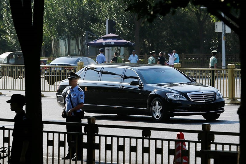 A car believed to be carrying North Korean leader Kim Jong Un drives down Chang'an Avenue towards Tiananmen Square in Beijing, China June 19, 2018. (Reuters Photo)