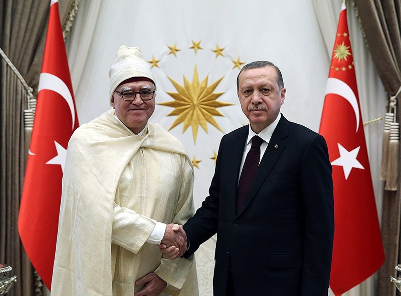 In this file photo on Jan. 18, 2017, President Recep Tayyip Erdou011fan receives newly appointed Moroccan envoy Menouar Alem (L) at the Beu015ftepe Presidential Complex in Ankara.
