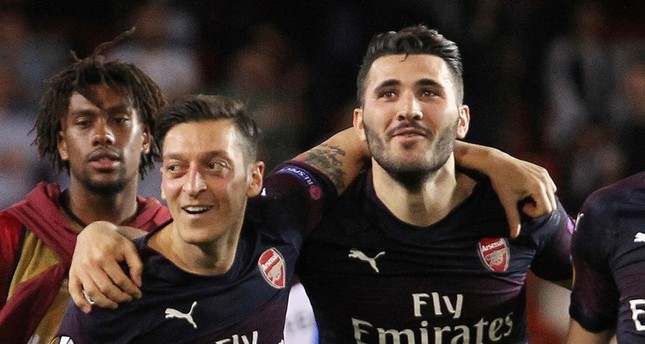In this May 9, 2019 file photo, Arsenal defender Sead Kolasinac R celebrates with Arsenal midfielder Mesut Özil at the end of the Europa League semifinal match in Valencia, Spain. AP Photo