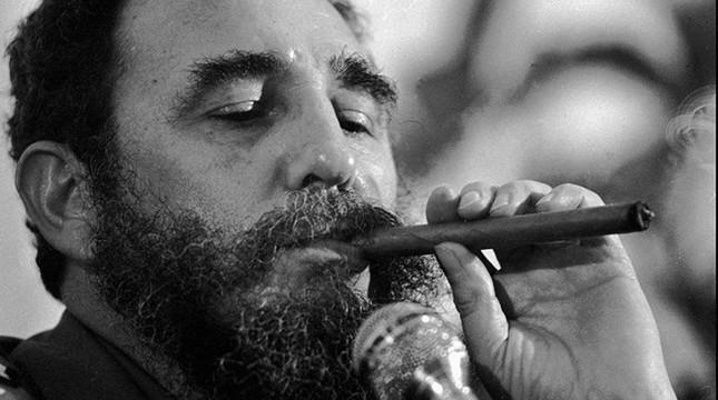 Undated file photo of Cuba's Fidel Castro smoking a cigar. (Sabah File Photo)