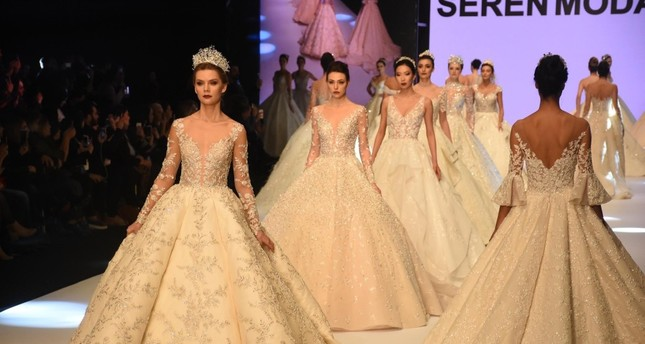 Models wear wedding dresses made by Turkish designers during a fashion show organized within the scope of IF Wedding Fashion İzmir, Jan. 23, 2019.