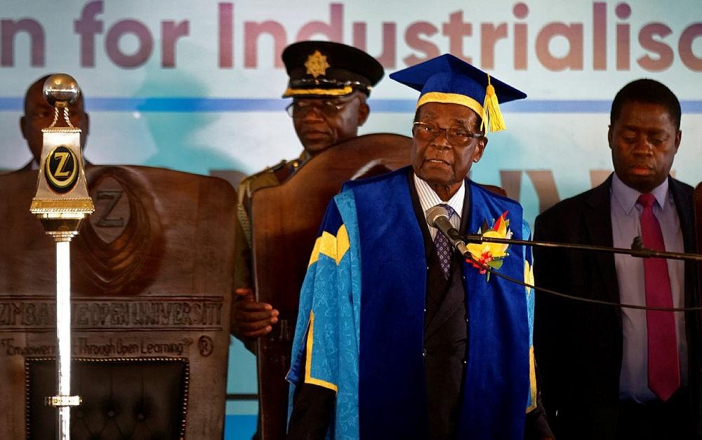 Zimbabwe's President Robert Mugabe, center-right, arrives to preside over a student graduation ceremony at Zimbabwe Open University on the outskirts of Harare, Zimbabwe Friday, Nov. 17, 2017. (AP Photo)