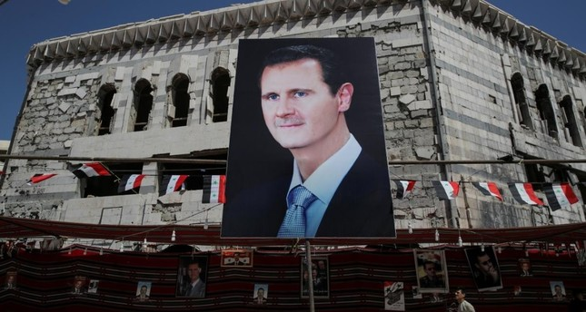 A man walks past a banner depicting Bashar al-Assad in Douma, outside Damascus, Syria, September 17, 2018. (Reuters Photo)