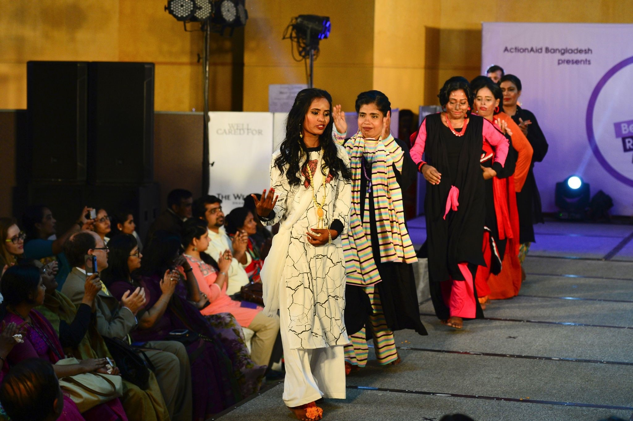 Bangladeshi acid attack survivors walk the runway during the fashion show ,Beauty Redefined, by designer Bibi Russell in Dhaka on March 7, 2017. (AFP Photo)