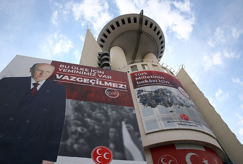 A giant Yes banner showing MHP leader Devlet Bahu00e7eli being displayed on MHP headquarters. (AA Photo)